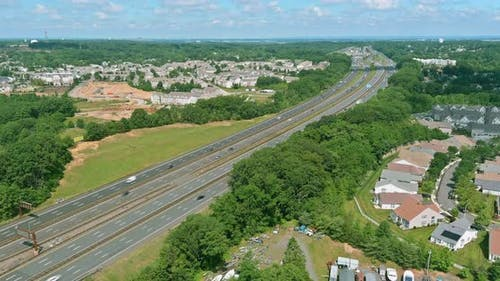 Top View of Numerous Cars in a High Speed Traffic in American Highway