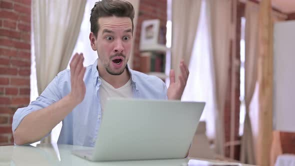 Thumbnail for Upset Young Man Get Shocked on Laptop