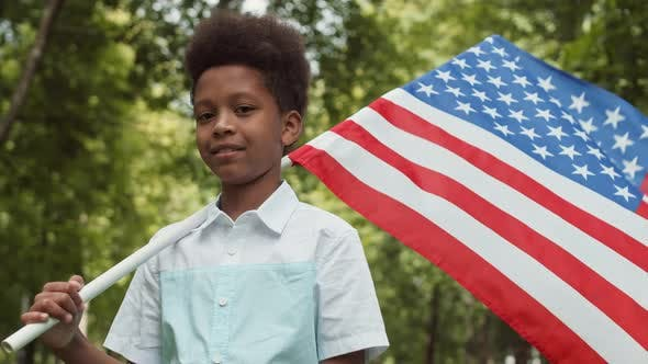 Thumbnail for Boy Holding American Flag Outdoors