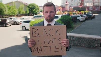 Businessman with Sign Black Lives Matter