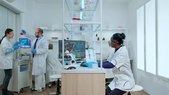 Thumbnail for Timelapse of Medical Team Working in Modern Reasearch Center