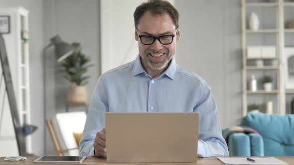Thumbnail for Online Video Chat By Old Businessman