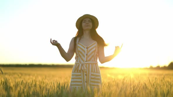 Girl Throws a Straw Hat at the Camera