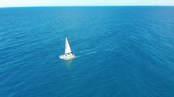 Cover Image for Yacht Sailing on Opened Sea. Sailing Boat. Yacht Seen From Drone. Yachting, Aerial