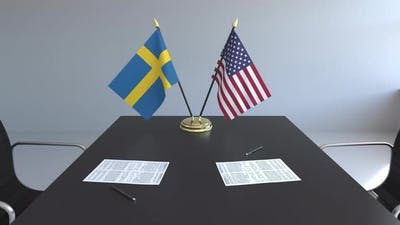 Flags of Sweden and the United States and Papers