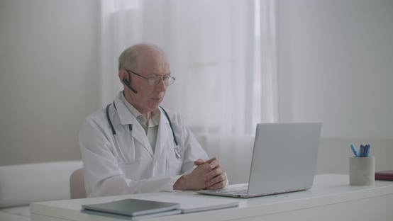 Thumbnail for Online Appointment with Therapist, Medical Specialist Is Sitting at Office in Clinic and Consulting