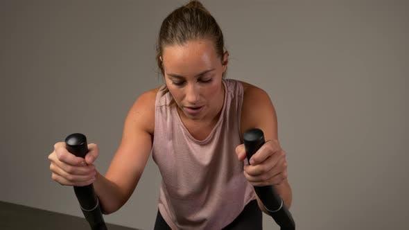 Athlete Sweating on Stationary Bike