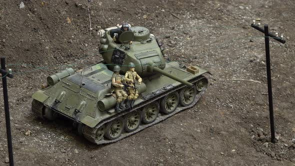 Thumbnail for An Exhibition of Army Car Models. A Close Up View of a Tank with Soldiers on It.