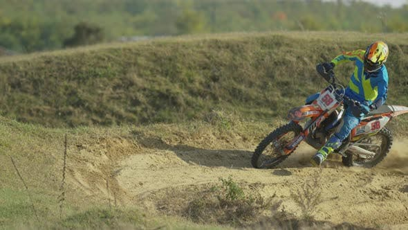 Thumbnail for Rider on a motocross leaving dust behind