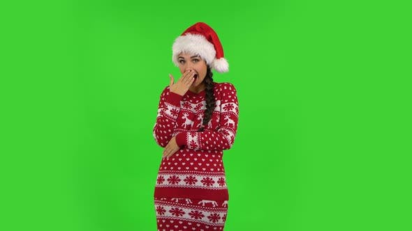 Thumbnail for Sweety Girl in Santa Claus Hat Is Laughing While Looking at Camera. Green Screen