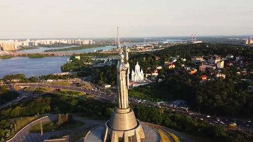 Aerial View of glorious The Motherland Monument located on the banks of Dnieper River