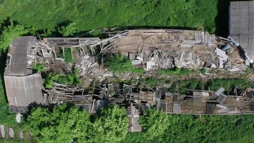 Top Drone Flight Over Destroyed Farm