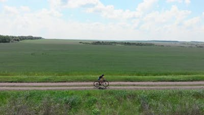 Cycling on gravel bike on trail road