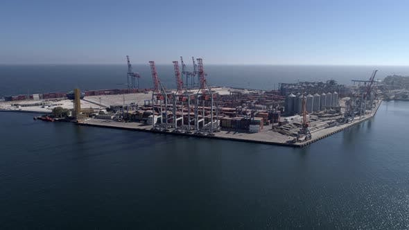 Thumbnail for Commercial Port with Container and Lifting Cranes on Sea Waterfront Against Blue Sky and Shiny Water