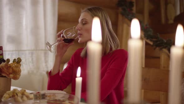 Thumbnail for Woman drinking wine at Christmas dinner