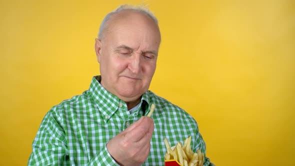 Thumbnail for Elderly Man Eating Fries