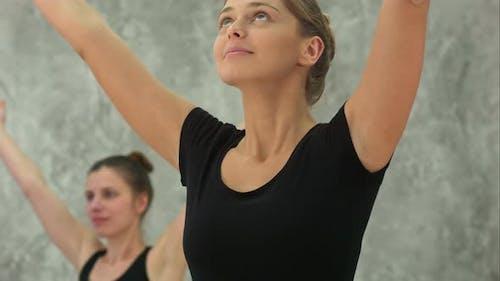 Beautiful Women Yoga Trainer Practicing in Yoga Class