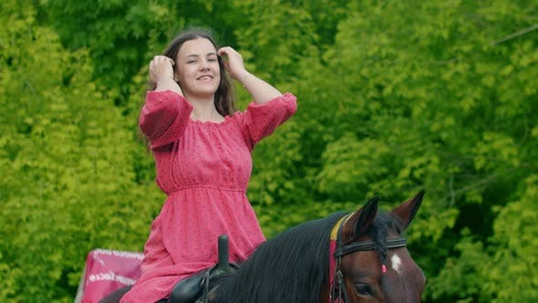 Thumbnail for Young Woman in Pink Dress Sitting on a Horse