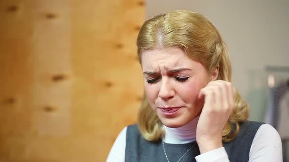 Blond Lady Having Toothache or Headache, Feeling Depressed