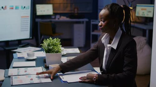 Focused Workaholic African American Businesswoman Working at Company Financial Charts Presentation