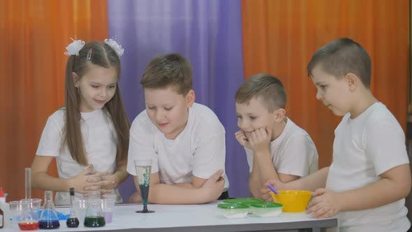 Chemical Experiments for Children. Fun Experiments for Children. Woman Adds Pills To a Clear Glass
