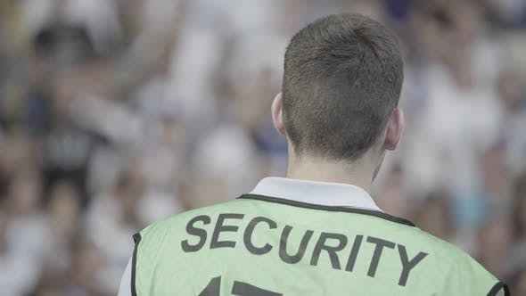 Thumbnail for Male Security Guard in a Stadium During a Football Soccer Match.