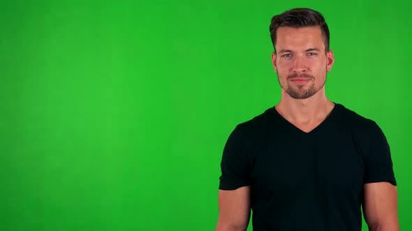 Thumbnail for Young Handsome Caucasian Man Agrees (Shakes with Head) - Green Screen - Studio