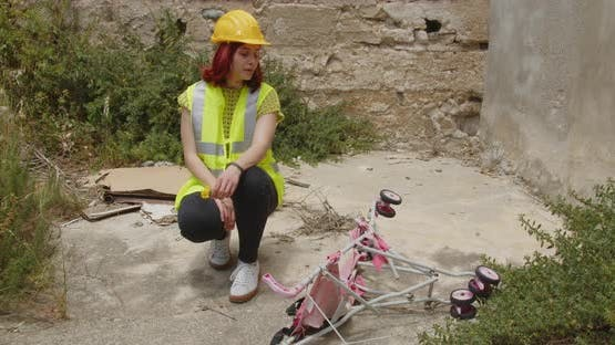 Female engineer looking at a stroller for bereaved children after the earthquake