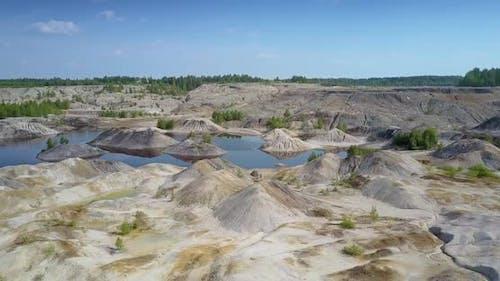 Lake Hides Behind Lifeless Clay Pit Petrified Surface