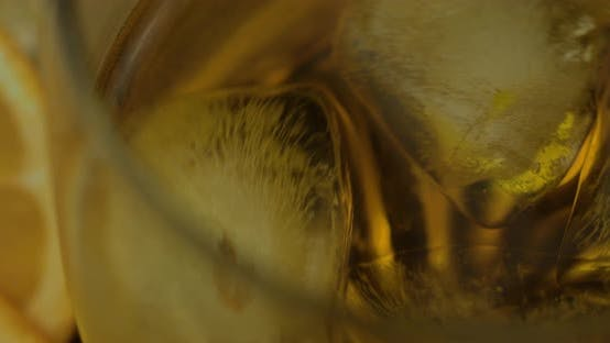 Thumbnail for Whiskey with Ice Cubes in Drinking Glass. Glass of Rum Alcohol