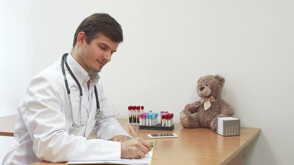Thumbnail for The Child's Doctor Writes Down Information About the Patient