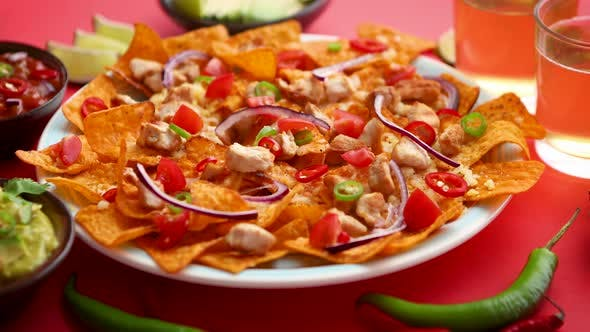 Thumbnail for A Plate of Delicious Tortilla Nachos with Melted Cheese Sauce, Grilled Chicken