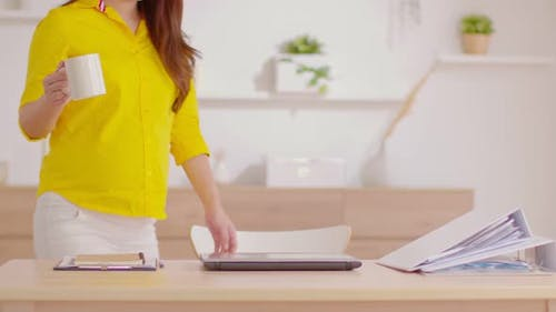 Asian Business woman start work open computer laptop in workplace smile with confident emotional