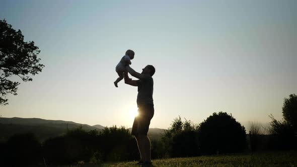 Thumbnail for View of a Strong Father Throwing His Little One Into the Air and Catching Him