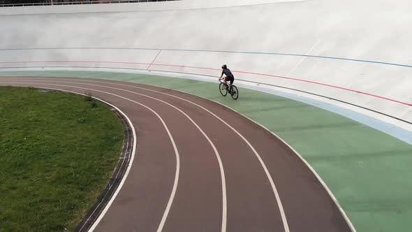 Thumbnail for Attractive Girl on Road Bike Is Riding on Bicycle Path at Velodrome