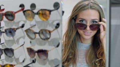 Beautiful Woman Choosing Sunglasses