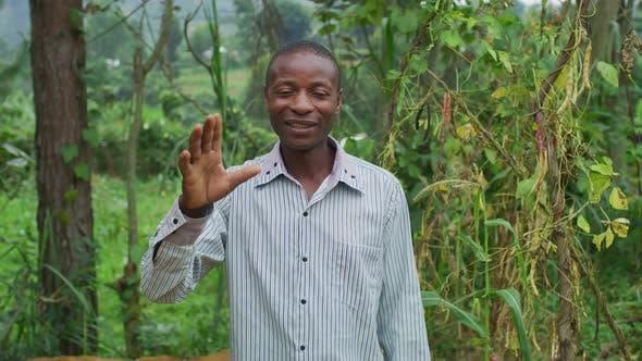 Thumbnail for African man waving hand