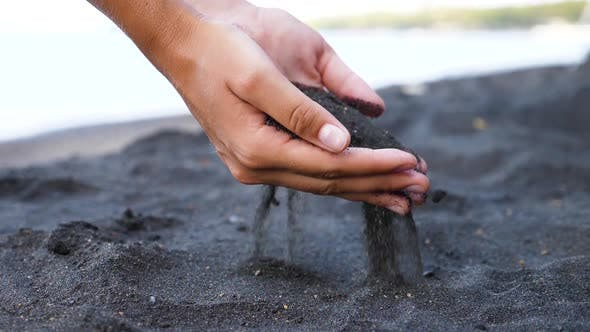 Thumbnail for Hand Pours the Sand.