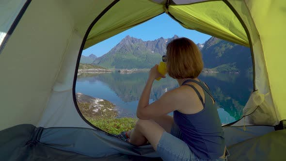 Thumbnail for Happy Woman Sitting in a Tent