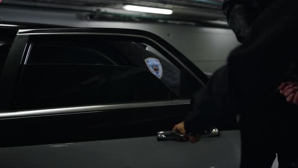 Policeman Guiding Man Into Police Car