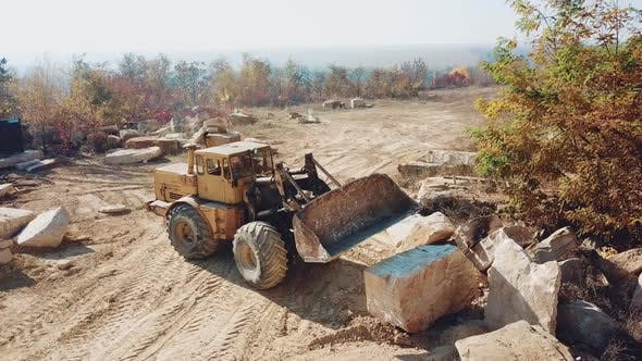 Thumbnail for Professional Bulldozer With a Bucket is Working in the Quarry With Stones