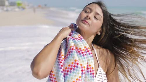 Woman Standing and Wiping with Towel