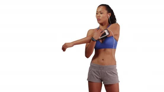 Thumbnail for Filipino woman runner stretching while listening to music on white background