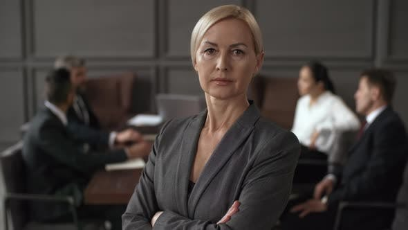 Thumbnail for Middle-Aged Caucasian Female Executive Posing during Business Meeting