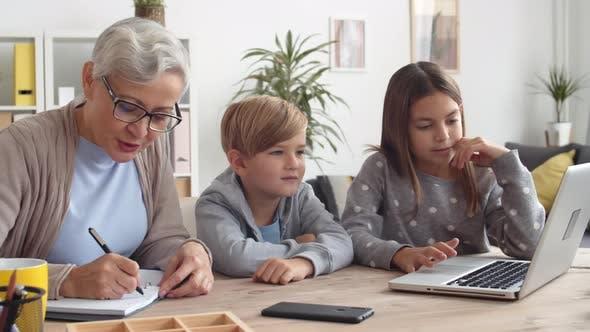Thumbnail for Grandmother and Grandchildren Mastering Laptop