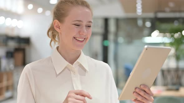Thumbnail for Portrait of Happy Young Businesswoman Doing Video Call on Tablet