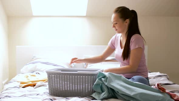 Thumbnail for Woman or Housewife Sorting Laundry at Home