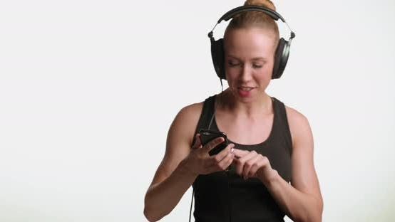 Thumbnail for Woman Listening to Music in Headphones