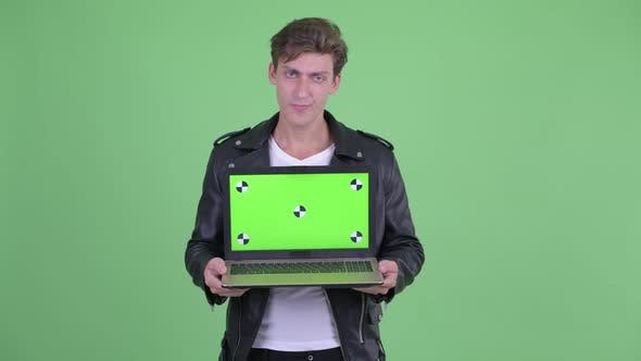 Thumbnail for Stressed Young Rebellious Man Showing Laptop