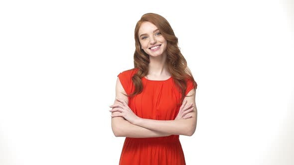 Thumbnail for Lifestyle Concept: Smiling Mystery Ginger Woman in Orange Gorgeous Dress Holding Crossed Arms and